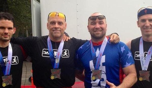 Team Celebrates After Triathlon T-Shirt Photo