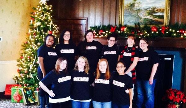 Gathered Aaround The Christmas Tree T-Shirt Photo