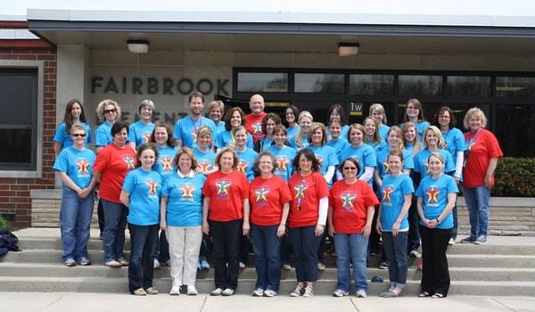 Staff Proudly Shows Off Superhero Spirit T-Shirt Photo