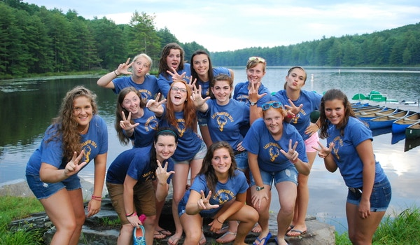 Girls Throwing Up The Young Life Symbol. T-Shirt Photo