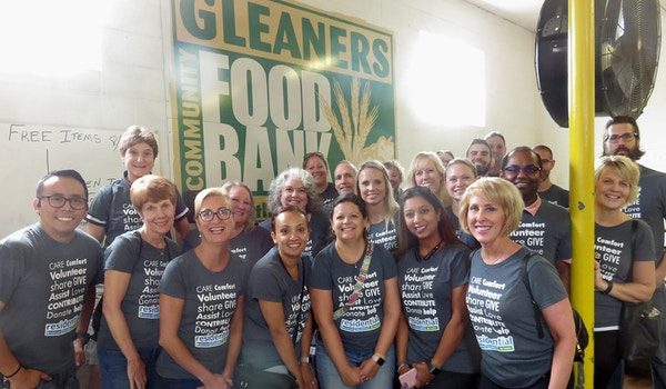The Residential Team Volunteering At Gleaners Community Food Bank T-Shirt Photo