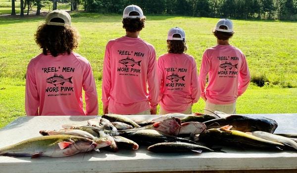 """""""Reel"""" Men Wore Pink T-Shirt Photo"""